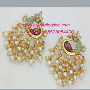 Exclusive matic finish kundan pearl earring code: 0519190N