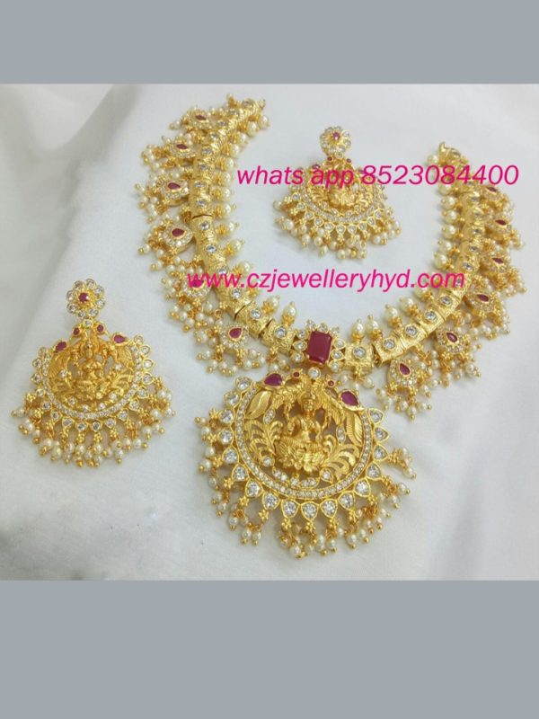 exclusive gold finish laxmi guttapusalu style set with hand setting ad stone 0619234N