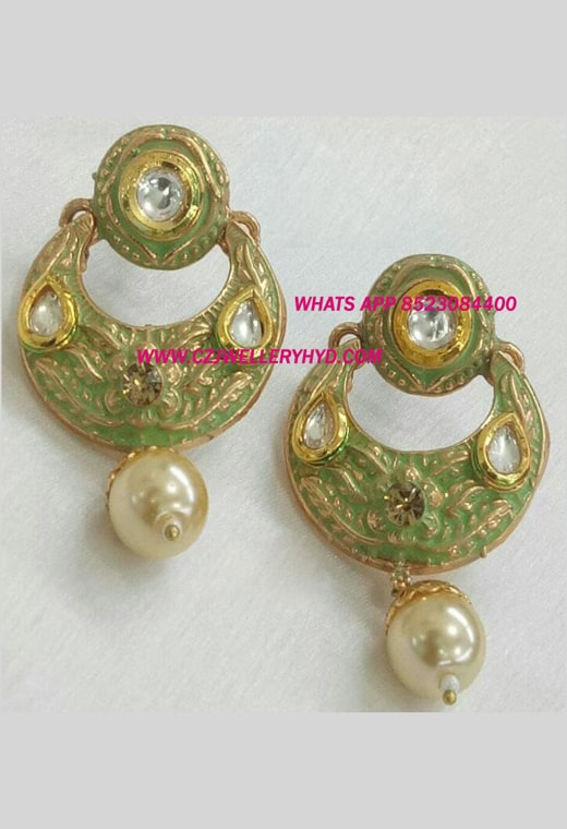 Exclusive Meena Earrings green colored Buy online